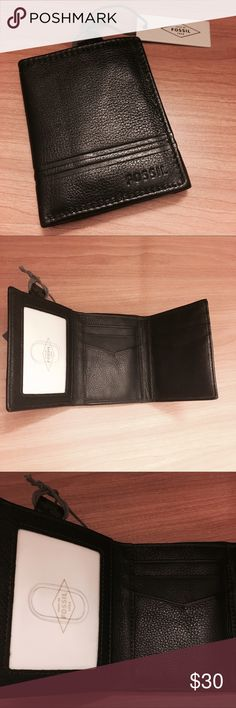 NWT Men's Fossil trifold wallet Genuine black leather wallet with brown stitching. Double stripe along the bottom. Fossil brand. Brand new wallet, tag on and never been used perfect condition. This is such a great deal for a good quality, expensive wallet. Fossil Bags Wallets