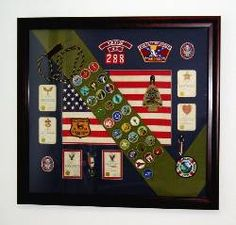Eagle Scout Shadow Box 2. Could do something like this for cub scouts, too.