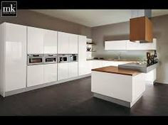 U Shaped Kitchen Idea Featured Sleek White Cabinets And Side By Side Wall  Ovens Plus Modern Wood Countertop Interesting And Inspiring Kitchen Wall  Ideas ...