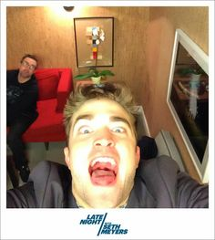 Rob on Late Night with Seth Myers, 6-17-14 (1) @Late Night with Seth Meyers: Is Robert Pattinson taking a selfie with the #LNSM Photo Booth, or practicing for his next trip to the dentist?   he's such a goof!