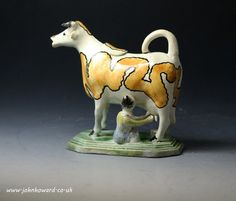 Antique English pottery cow creamer circa 1800 - Antique Staffordshire Pottery of John Howard