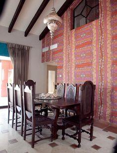 """Luxury Moroccan living room, designed by Jonty Lewis, featured on """"Marbella Mansions"""".  Love this wallpaper. #JontyLewis #MarbellaMansions #Darkwoodtable #Darkwoodchair #Pearlceilinglight @JontyLewis @Bocadolobo"""