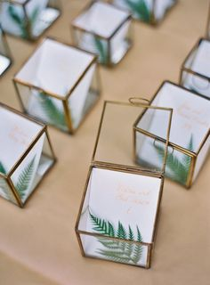 Display your guest names + table number with a fern or a plant sprig for a wonderful wedding favor.