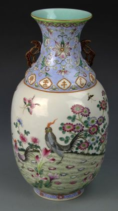 China, 19th C., Famille Rose vase, with painted scene of birds and butterflies in a garden setting, purple ground at neck, featuring auspicious symbols and ears, Qianlong mark. Height 11 3/4 in., Width 6 in.