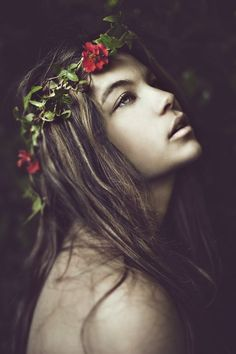 wild child, vacant expression, nature interaction, plant crown, faded/vintage colors, messy hair, implied nudity