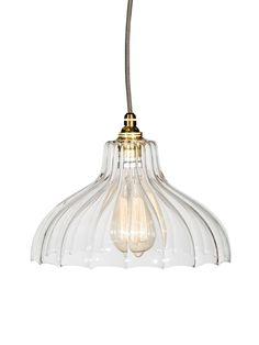 Beautifully handcrafted in the UK, our ribbed glass dome pendant lights are individually hand blown and crafted by local craftsmen. Each glass shade is made from the highest quality glass, with soft ribbed detail and scalloped edges, and reflect light beautifully across a room. The Fluted Glass Factory Pendant, is finished with brass fittings and ceiling rose, and a grey fabric flex.   Click here to view our useful lighting buying guide, and take a look at our blog for ideas on how…