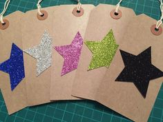 Pack of 5 fabulous manila gift tags with string with a handpunched glitter star on the front. Colours included are pink, blue, silver, gold and black.  If you need larger quantities then please get in touch.