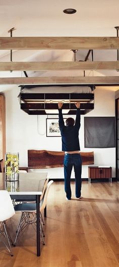 Retractable bed in the tiny home of Vincent Kartheiser (from Mad Men). I'm kinda geekin' out on this bed...and the fact that Vincent Kartheiser lives in a tiny house!