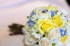 yellow & blue bridal bouquet | Nathan & Wendy's personalized, geeky Waterfront Maryland wedding | Images: The Messenger Image