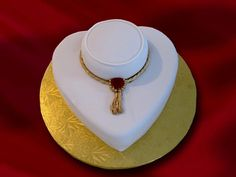 ADSC_Necklace Display - For a jewelry store......red velvet cake with a chocolate ganache filling. Isomalt jewel and fondant embelleshments. TFL!