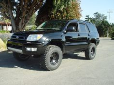 lift wheels and tires!!!! Chris wants his runner to look like this cept with a brush guard