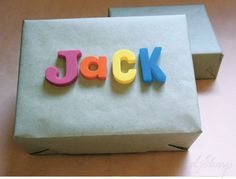 Include a thin strip of metal in your wrapping, then label with magnetic letters