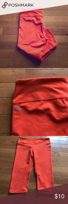 """Bright orange Fabletics crops! 👟👟 Bright orange Fabletics crops, maybe more correctly defined as a Capri, they fall about 3"""" under my knees and I'm almost 5' 5"""". Perfect for this spring! Size medium. Fabletics Pants Capris"""