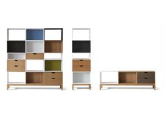 A series of shelving units made from open and closed boxes and drawer sections in timber and lacquered finishes.