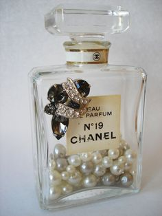 cute idea to recycle a perfume bottle- add pearls and a cute brooch or gem! Empty Perfume Bottles, Vintage Perfume Bottles, Bottles And Jars, Perfume Tray, Chanel Perfume, Cute Crafts, Diy Crafts, Mason Jar Drinks, Altered Bottles