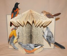 """""""Bird House Book Sculpture"""" Each bird is hand drawn and colored. Available for sale."""