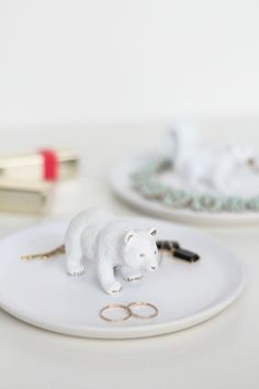 Turn an appetizer plate and a plastic figurine into a cool display item.  LuLu*s Fresh Spaces: DIY Figurine Trinket Dishes - Lulus.com