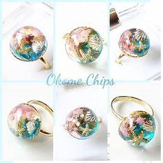 WEBSTA @ okomechips - .1つの指輪を色んな角度から撮ってみました(*^_^*)角度を変えることで違った可愛さを見せてくれます(*^_^*).こちらはオルゴナイトではありません.#レジンアクセサリー #レジン #okomechips #おこめちっぷす Ice Resin, Resin Ring, Resin Jewelry, Glass Jewelry, Stone Jewelry, Beaded Jewelry, Gem Diamonds, Baubles And Beads, Seashell Crafts