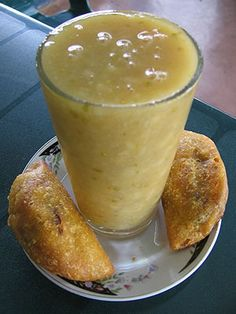 Champús. 'Champús is a drink popular in southwest Colombia (Departments of Valle del Cauca, Cauca and Nariño), made with maize, fruits such as lulo (also known as naranjilla), pineapple, quince or guanábana, sweetened with panela and seasoned with cinnamon, cloves and orange tree leaves.' http://www.lonelyplanet.com/peru
