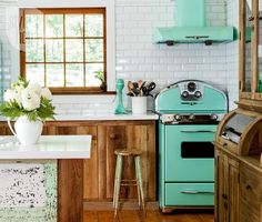 Bright eclectic cottage, neutral background with bright vintage style turquoise cooker and extractor #welovehomeblog