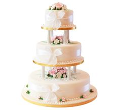 Patisserie Valerie - Wedding Cakes - Classic Sugar Paste Style -   The pillars penetrate each tier of cake which in turn supports the cake above giving the impression of a traditional English style wedding cake with the benefit of a continental cake filling.