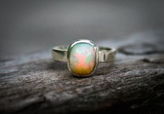 Opal Ring Size 7.5 - Engagement Ring Alternative - Opal Ring - firey opal -Opal Sterling Silver Ring - Ring size 7.5 - October Birthstone by NaturalRockShop on Etsy https://www.etsy.com/listing/193884227/opal-ring-size-75-engagement-ring