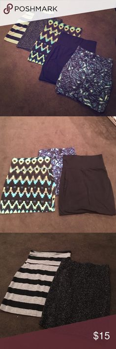 Bandeau skirts 5 assorted bandeau skirts. Black glitter -XS. Black and grey striped-XS. Solid black - S. Black and blue lightning-S. Aztec print-S. Used- gently worn, in great condition. Available in a bundle for $15 or single skirt at $5 each. Lily White Skirts Mini