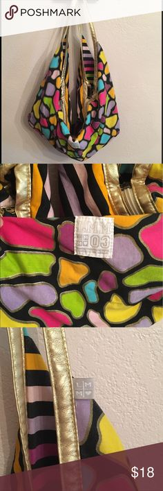 Little Miss Matched spacious colorful purse tote Little miss matched spacious purse/tote/bag. Striped on one side with a colorful animal print on the other. Gold and black interior with pockets. Gold leather like trim on handles. Excellent condition! Super fun prints! Perfect for summer or back to school!💕 little miss matched Accessories Bags