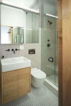 Beautiful small bathroom - timber, white, hexagonal tiles, black fixtures.