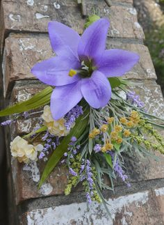 A single iris with a soft spray makes this a top pick for your rustic themed wedding