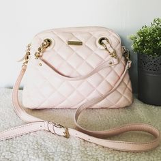 """Kate Spade  Pink Georgina Satchel Quilted, pebbled calfskin features metallic foil coating for subtle sheen. Golden hardware. Removable, buckle adjustable shoulder/crossbody strap with 19"""" drop. Woven chain tote handles with leather inset and 4"""" drop; anchored by grommets. Domed zip top. Golden kate spade new york logo plate on front. Fabric lining; inside, one zip and two open pockets. 9""""H x 13""""W x 5""""D.  Bag is a little dirty on bottom and top edge as well as a few stains inside. kate spade…"""