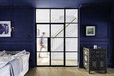 Living room with Crittall screen.  Designed by PLANSTUDIO (hello@planstudio.uk) Photography: Gautier Houba
