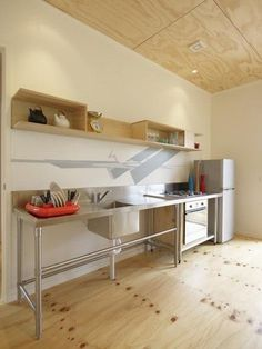 Remove full-size fridge and replace oven with mini fridge in its place... PERFECT!