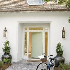 White Beach Home with Light Green Front Door