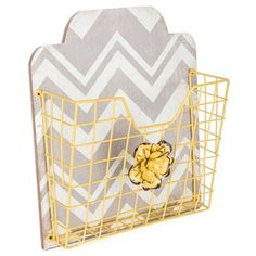 """A clutter-free office inspires productivity, creativity, and prosperity. Use this stylishChevron Wall Organizer with Yellow Wire Basketto get your workspace in tip-top shape! Featuring a distressed white and gray chevronMDF background, a yellow wire basket, and coordinating distressed yellow layered metal flower, this organizer is sure to add both function and beauty to your home or office.    Dimensions:      Width: 11 3/4""""    Height: 13 5/8""""   ..."""