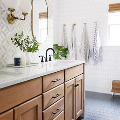 Modern Farmhouse Bathroom Renovation: Gorgeous wooden vanity with carrara marble countertop and mid century style knobs and pulls from Schoolhouse electric. This bathroom also features a blue herringbone tile floor and marble mosaic tile backsplash. Bad Inspiration, Bathroom Inspiration, Bathroom Inspo, Ideas Baños, Decor Ideas, Decorating Ideas, Decor Diy, Tile Ideas, Rustic Decor