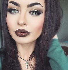 Intense brows, pale skin highlighted with just the right amount of deep-toned blush/bronzer, and a bold eye look paired with a killer dark lip. This is awesome.