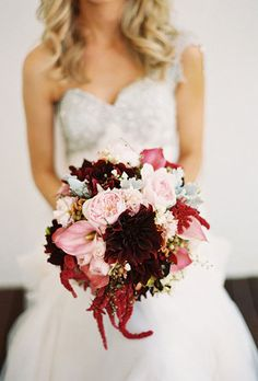 A Fall Bouquet of Red and Pink Dahlias, Calla Lilies, and Peonies. A mixed bouquet made of peonies, irises, dahlias, and dusty miller, created by Art Stems on Lygon.