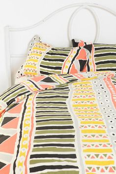 We want to cozy up under this colorful sham - Affordable Summer Decor 2013