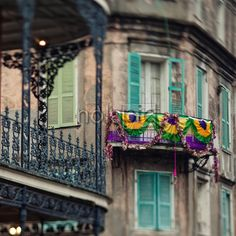 """Maison LeMonnierDr. LeMonnier's home, on Royal St in the French Quarter in New Orleans, referred to as """"New Orleans' first skyscraper"""" which towers three stories high. In the foreground are the elaborate cast-iron gallery railings of LaBranche House.#NewOrleans #FrenchQuarter #NolaPic.com #PompoBresciani"""