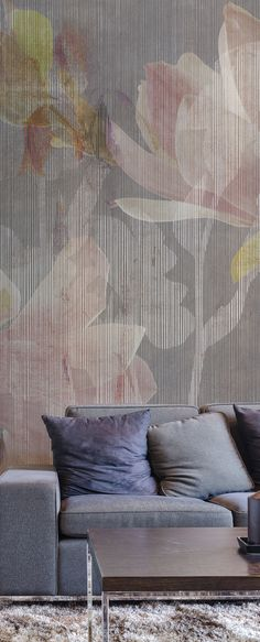 """Forget about your granny's floral wallpaper, """"Magnolia"""" is the new way to make a wall a masterpiece. It fits really well in this relax area with the same color shades as the sofa. #Tecnografica #ItalianWallcoverings"""