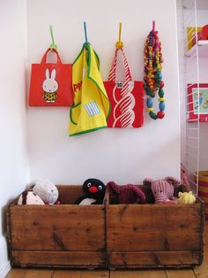Love the wood crates and bright hooks. #organization
