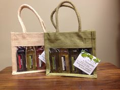 Flying Olive Jute Bag Gift Set. Includes 4 olive oil and/or balsamic vinegars of your choosing. Mix and Match! 513.943.1900