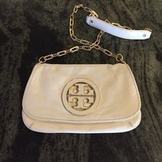 Tory Burch logo clutch Pre-loved. Minor signs of wear shown in pictures. Inside of bag is clean for a pre-loved bag. Gold hardware. Great condition. Tory Burch Bags