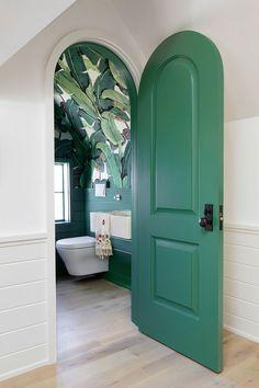 A green arch door opens to a contemporary powder room boasting palm leaf print wallpaper lined with a green shiplap trim. Attic Bathroom, Small Bathroom, Funky Bathroom, Bathroom Vinyl, Zen Bathroom, Tropical Bathroom, Marble Bathrooms, Remodel Bathroom, Bathroom Interior Design
