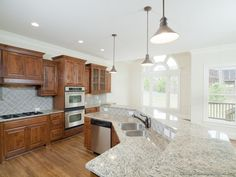 #Kitchen Idea of the Day: Golden brown kitchen with large bi-level angled island in a great room layout.