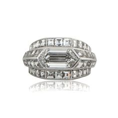 A beautiful and Rare 1920's Art Deco Engagement Ring. This antique engagement ring is set in platinum mounting and adorned with many beautiful diamonds.