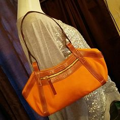 """KATE SPADE Burnt Orange & Leathet Shoulder Bag Brand: Kate Spade Item: Burnt Orange Canvas Bag with Brown Leather Trim.  One zippered pocket outside on each side.  Inside 1 wide zippered pouch & 1 wide pouch. Floral interior, magnetic closure Color: Orange Measurements: 15""""w 6.5""""h x 4""""d.  Drop is 10.5"""" Materials: Cotton Canvas & Leather Condition: Excellent pre-loved Condition.  Please check my other items.? I list many small things and you would only pay one shipping charge.? 10% off 4…"""