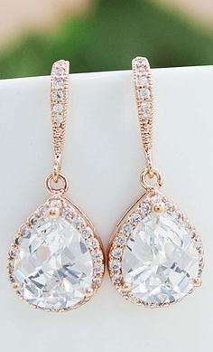 Rose gold and diamond drop earrings.