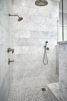 Catrin Mead saved to basement remodeling this beautiful walk-in, zero-entry master bathroom shower, the walls are honed White Carrera Marble installed in a traditional subway pattern using larger format tile. The shower floor is a…More White Marble Bathrooms, Modern Small Bathrooms, Small Bathroom Tiles, Master Bathroom Shower, Amazing Bathrooms, Bathroom Ideas, Shower Ideas, Bathroom Wall, Tiled Bathrooms